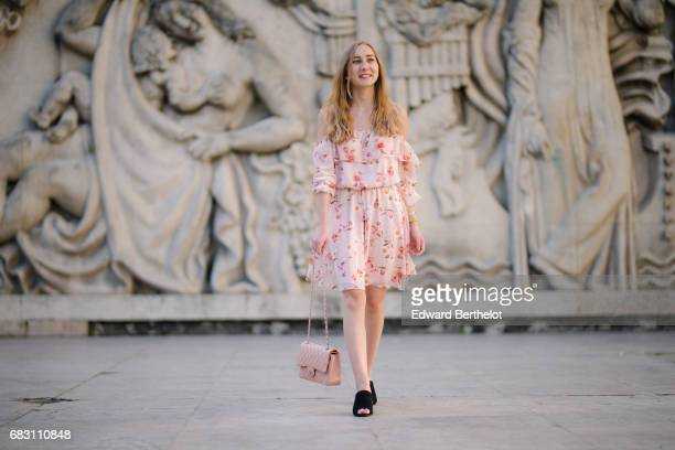 Oceane grilhe fashion blogger The Blondie World wears a New Look pink floral print dress New Look shoes and a Chanel pink bag at Palais de Tokyo on...