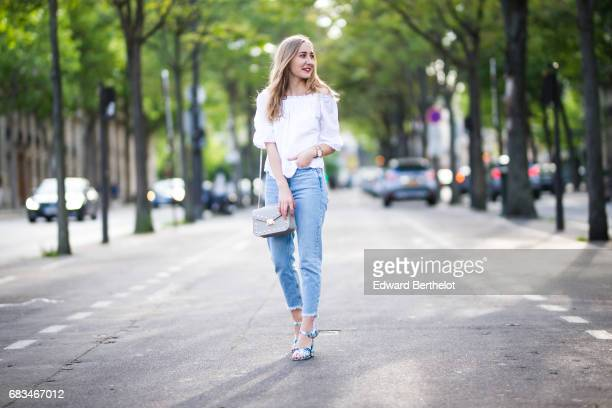 Oceane Grilhe fashion blogger The Blondie World wears New Look blue denim jeans a New Look white lace top New Look floral print shoes a bag and a...