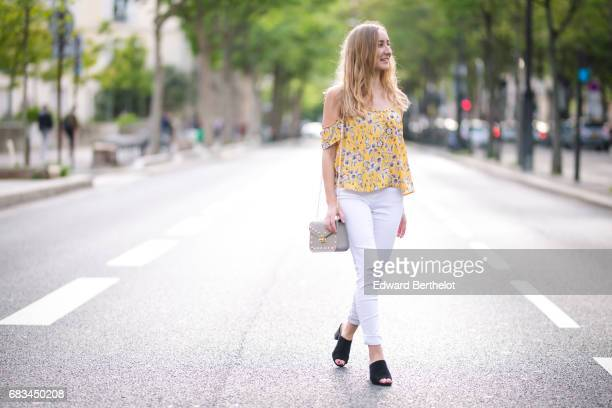 Oceane Grilhe fashion blogger wears Cache Cache white ripped denim jeans a Primark yellow off shoulder flower print top New Look shoes and a bag on...