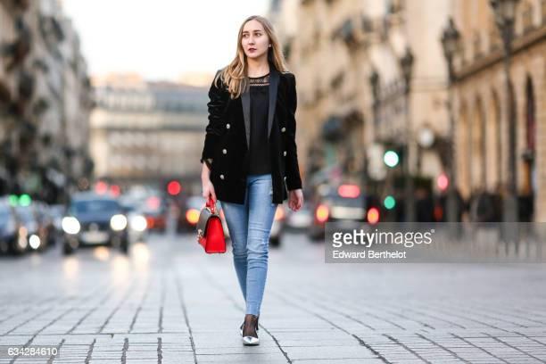 Oceane Grilhe wears Stradivarius silver shoes Calzedonia fishnet tights Stradivarius blue denim jeans pants a Morgan black jacket a black and red...