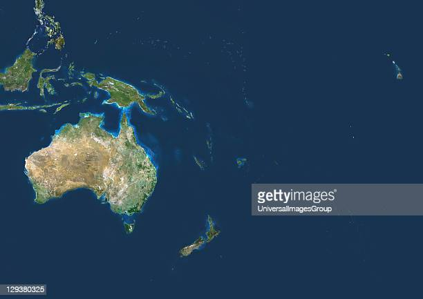 Oceania True colour satellite image centred on the region of Oceania North is at top Water is blue vegetation is green and arid areas are brown...