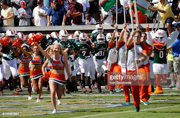 The Miami Hurricanes football team take the field prior to the NCAA football game between the Georgia Tech Yellow Jackets and the Miami Hurricanes at...