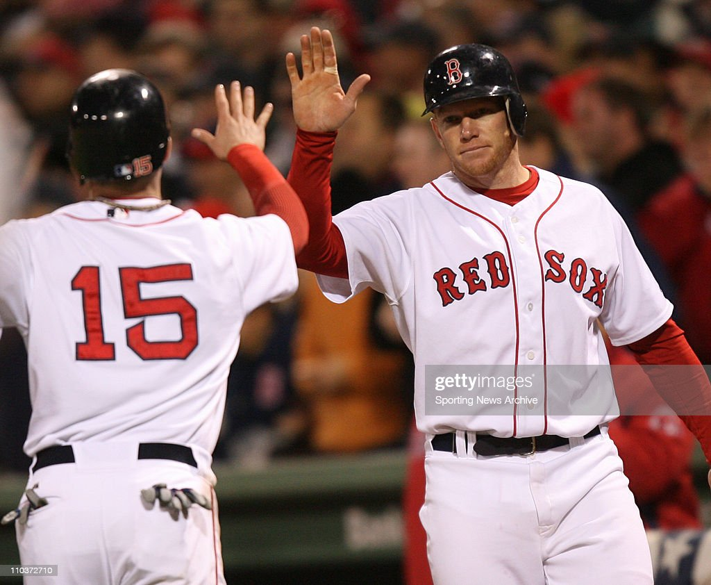 Oct 12, 2007 - Boston, MA, USA - The Cleveland Indians against the Boston Red Sox as DUSTIN PEDROIA, left, is congratulated by BOBBY KIELTY after crossing the plate during game #1 of the American League Championship Series at Fenway Park. The Red Sox won 10-3.