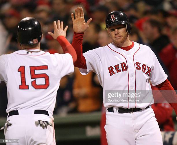Oct 12 2007 Boston MA USA The Cleveland Indians against the Boston Red Sox as DUSTIN PEDROIA left is congratulated by BOBBY KIELTY after crossing the...