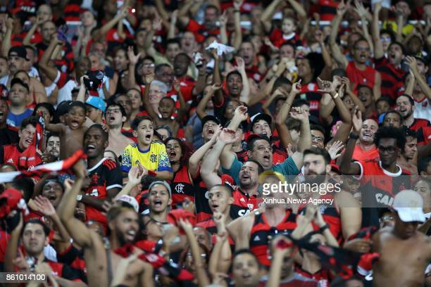 JANEIRO Oct 13 2017 Supporters of Flamengo celebrate after Rever scores during the 2017 Brazilian Serie A 27th round match between Fluminense and...