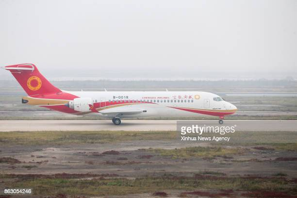 SHANGHAI Oct 14 2017 An ARJ21700 jetliner taxiing down a runway at Shengli Airport in Dongying of east China's Shandong Province China's first...