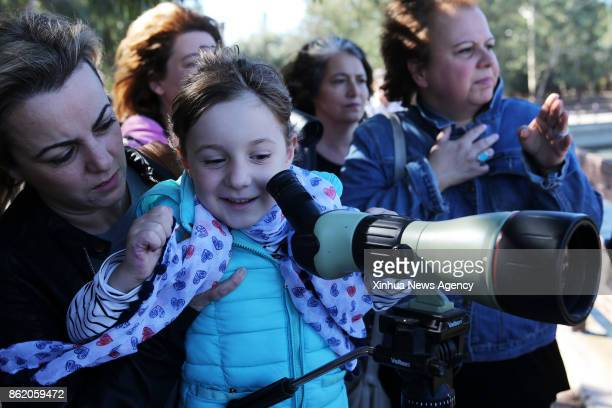 ATHENS Oct 15 2017 A child observes birds through telescope at the 'Antonis Tritsis' Environmental Education Sensitization Park in the northern...