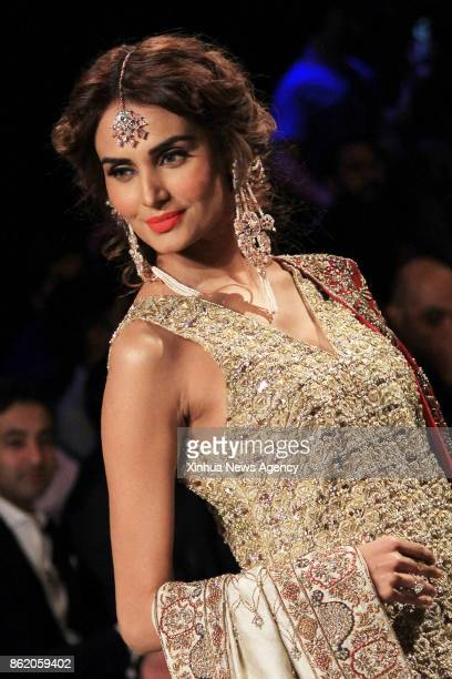 LAHORE Oct 15 2017 A model presents a creation by designer Mahgul on the second day of the Pakistan Fashion Design Council Bridal Fashion Week in...