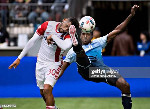 VANCOUVER Oct 15 2017 Anibal Goday of San Jose Earthquakes vies with Aly Ghazal of Vancouver Whitecaps during the MLS regular season match between...