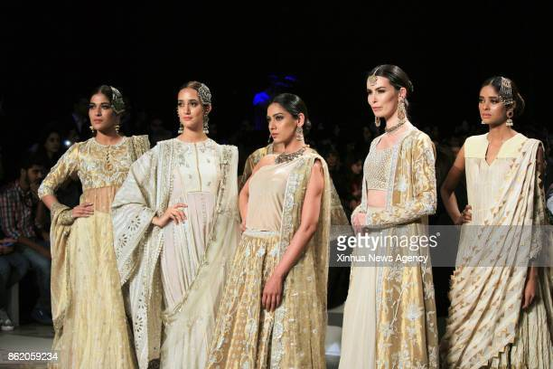 LAHORE Oct 15 2017 Models present creations by designer Misha Lakhani on the second day of the Pakistan Fashion Design Council Bridal Fashion Week in...