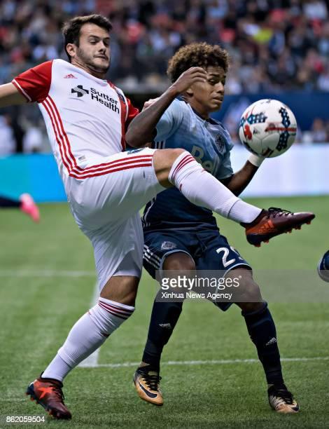 VANCOUVER Oct 15 2017 Valeri Qazaishvili of San Jose Earthquakes vies with Yordy Reyna of Vancouver Whitecaps during the MLS regular season match...