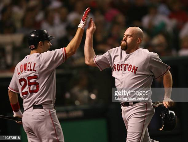 Oct 16 2007 Cleveland OH USA The Cleveland Indians against the Boston Red Sox KEVIN YOUKILIS scores and high fives MIKE LOWELL at Jacobs Field in...