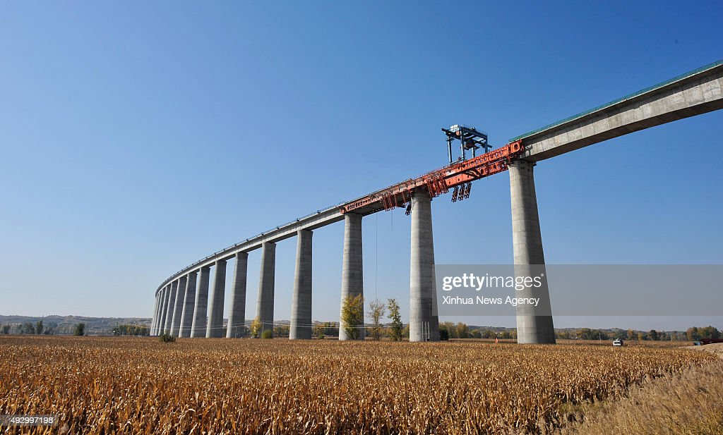 HOHHOT Oct 16 2015 Workers construct a bridge of the HohhotJungarErdos Railway on the Yellow River in north China's Inner Mongolia Autonomous Region...