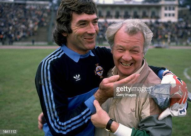 Northern Ireland goalkeeper Pat Jennings and Northern Ireland Manager Billy Bingham share a joke before a World Cup qualifying match against Romania...