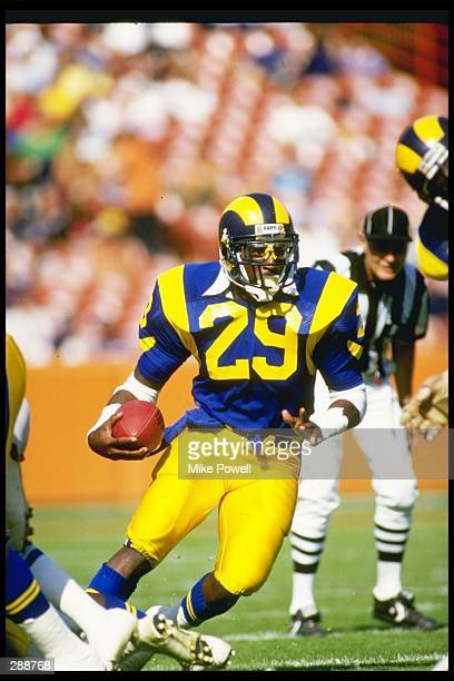 Running back Eric Dickerson of the Los Angeles Rams moves the ball during a game against the Detroit Lions at Anaheim Stadium in Anaheim California...