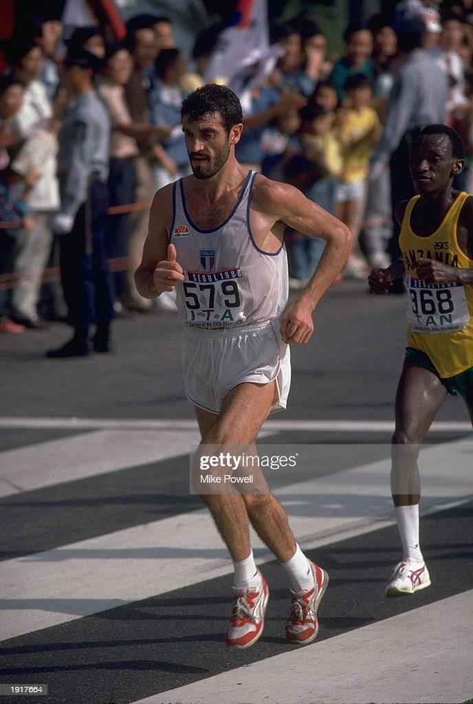 Gelindo Bordin #579 of Italy leads Juma Ikangaa #168 of Tanzania during the Marathon event at the 1988 Olympic Games in Seoul, South Korea. \ Mandatory Credit: Mike Powell/Allsport