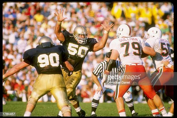 Nose tackle Chris Zorich of the Notre Dame Fighting Irish puts the pressure on during a game against the Miami Hurricanes at Notre Dame Stadium in...