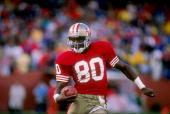 Wide receiver Jerry Rice of the San Francisco 49ers runs down the field during a game against the Los Angeles Raiders at Candlestick Park in San...