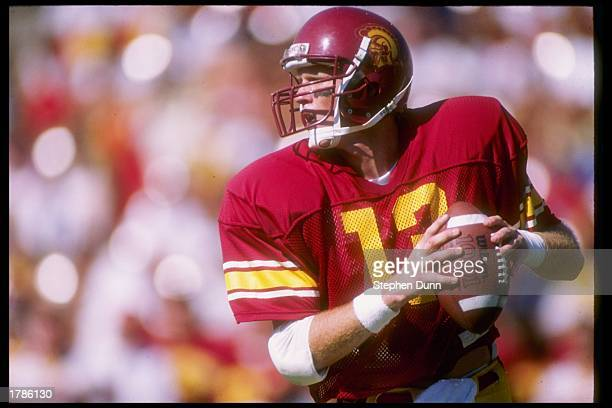 Quarterback Todd Marinovich of the USC Trojans drops back to pass during a game against the Washington Huskies at the Los Angeles Memorial Coliseum...