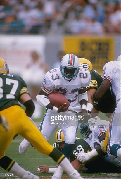 Wide receiver Troy Stradford of the Miami Dolphins runs with the ball during a game against the Green Bay Packers at Joe Robbie Stadium in Miami...