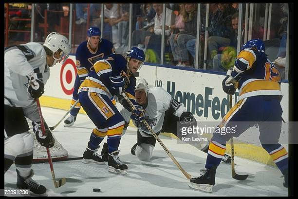 Center Cliff Ronning of the St Louis Blues works against the Los Angeles Kings during a game at the Kiel Center in St Louis Missouri Mandatory Credit...