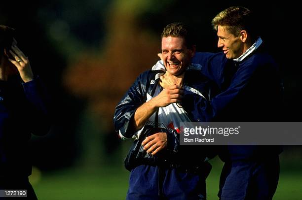 Chris Waddle of England attempts to strangle team mate Paul Gascoigne during a training session Mandatory Credit Ben Radford/Allsport