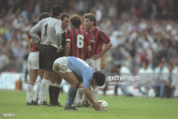 Diego Maradona of Napoli places the ball on the penalty spot during a match against AC Milan at the San Paolo Stadium in Naples Italy Mandatory...