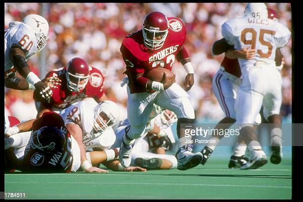 Fullback Kenyon Rusheed of the Oklahoma Sooners runs down the field during a game against the Texas Longhorns at the Cotton Bowl in Dallas Texas...