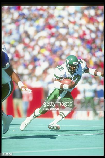 Running back Blair Thomas of the New York Jets moves the ball during a game against the Buffalo Bills at Rich Stadium in Orchard Park New York The...