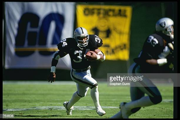 Running back Bo Jackson of the Los Angeles Raiders runs down the field during a game against the San Diego Chargers at the Los Angeles Coliseum in...