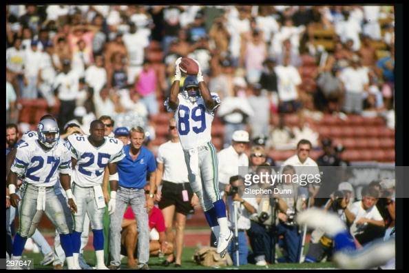 Wide receiver Brian Blades of the Seattle Seahawks catches the ball during a game against the Los Angeles Raiders at the Los Angeles Memorial...
