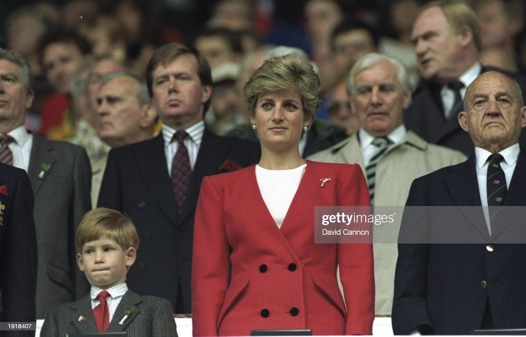 <a gi-track='captionPersonalityLinkClicked' href=/galleries/search?phrase=Princess+Diana&family=editorial&specificpeople=167066 ng-click='$event.stopPropagation()'>Princess Diana</a> and HRH <a gi-track='captionPersonalityLinkClicked' href=/galleries/search?phrase=Prince+Harry&family=editorial&specificpeople=178173 ng-click='$event.stopPropagation()'>Prince Harry</a> stand for the National Anthem at the Wales v Australia match during the 1991 World Cup at Cardiff Arms Park in Cardiff, Wales. Australia won the match 34-3. \ Mandatory Credit: David Cannon/Allsport