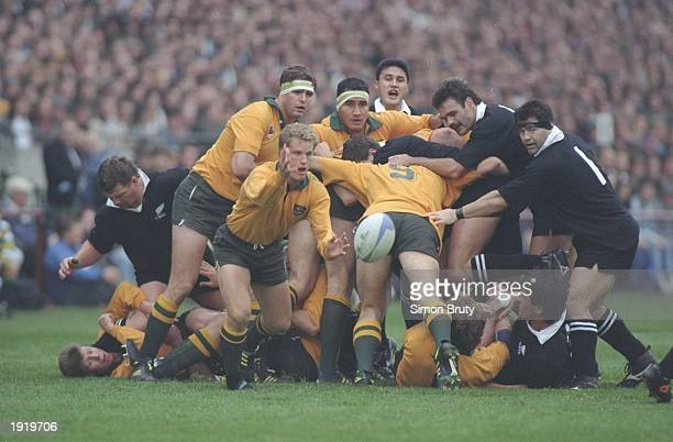 Michael Lynagh of Australia passes the ball out from a maul during the World Cup semifinal against New Zealand at Lansdowne Road in Dublin Ireland...