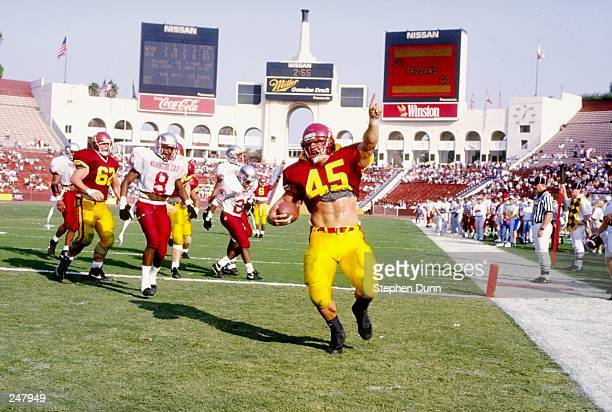 Fullback Wes Bender of the USC Trojans makes a touchdown during a game against the Washington State Cougars at the Los Angeles Memorial Coliseum in...