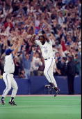 Firrst baseman Joe Carter of the Toronto Blue Jays celebrates after a home run in the ninth inning during the World Series against the Philadelphia...