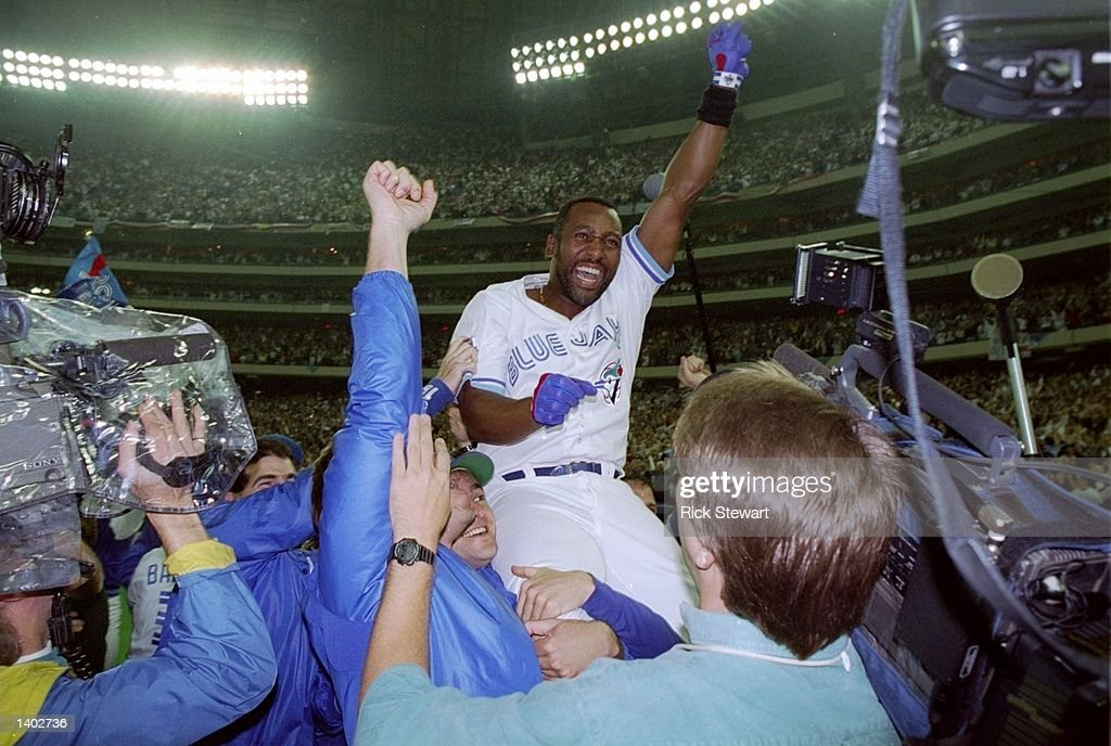 Firrst baseman Joe Carter of the Toronto Blue Jays celebrates after the World Series against the Philadelphia Phillies at the Toronto Sky Dome in...
