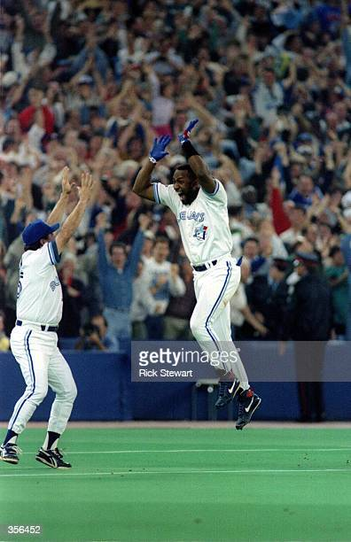 Joe Carter of the Toronto Blue Jays celebrates his 9th inning 3 run homerun to defeat the Philadelphia Phillies 86 to win the 1993 World Series at...