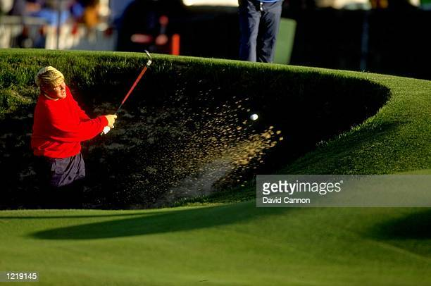 John Daly of the USA plays out of the RoadHole bunker during the Alfred Dunhill Cup at St Andrews Golf Club in Fife Scotland Mandatory Credit David...