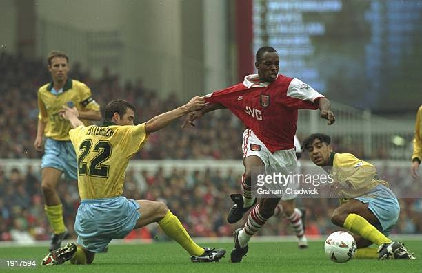 Darren Patterson of Crystal Palace holds back Ian Wright of Arsenal during an FA Carling Premiership match at Highbury Stadium in London Mandatory...