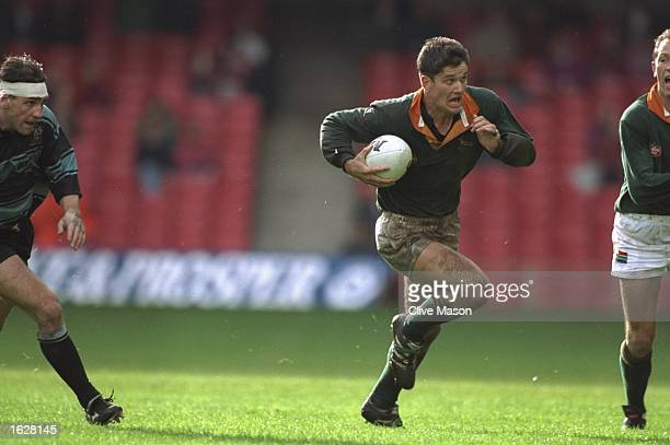 Joost Van Der Westhuizen scrumhalf for South Africa sprints with the ball during the match against Cardiff at Cardiff Arms Park in Cardiff Wales...
