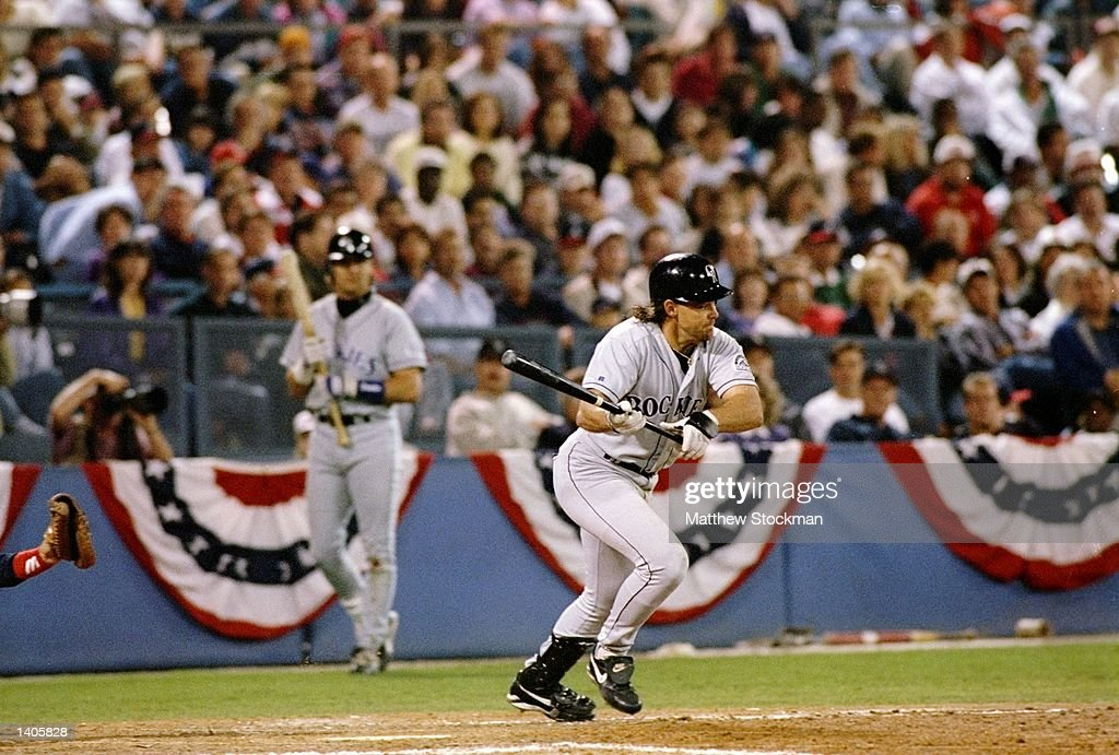 Center fielder Dante Bichette of the Colorado Rockies swings at the ball during a playoff game against the Atlanta Braves at Fulton County Stadium in...