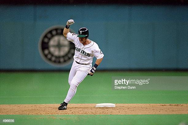 Edgar Martinez of the Seattle Mariners runs around second base after hitting a grand slam during the game against the New York Yankees at the...