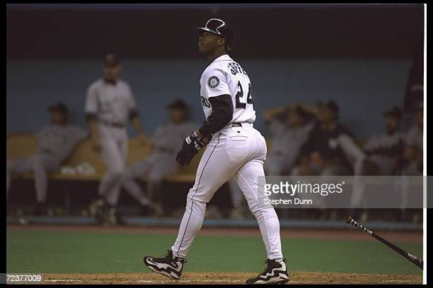 Ken Griffey Jr of the Seattle Mariners follows his home run as he goes to base during the game against the New York Yankees in the American League...