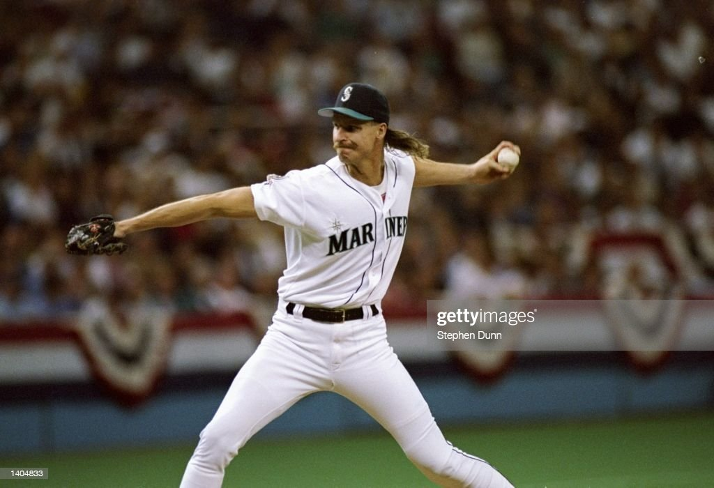 Pitcher Randy Johnson of the Seattle Mariners prepares to throw the ball during a game against the New York Yankees at the Kingdome in Seattle...