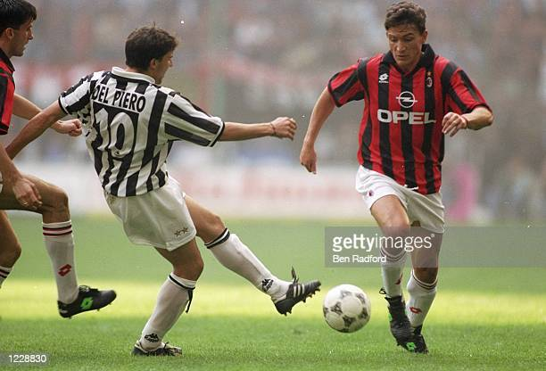 Stefano Eranio of AC Milan takes on Alessandro del Piero of Juventus during a Series A match at the San Siro Stadium in Milan Italy AC Milan won the...