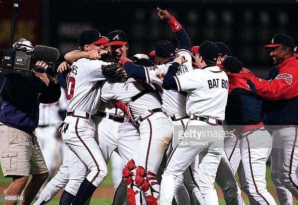The Atlanta Braves celebrate after winning game four of the NLCS against the Cincinnati Reds at Fulton Stadium in Atlanta Georgia The Braves defeated...
