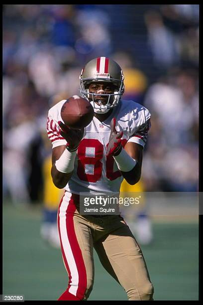 Wide receiver Jerry Rice of the San Francisco 49ers catches a pass during warmsups prior to the 49ers 4410 win over the St Louis Rams at Busch...