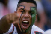 A fan of the Miami Hurricanes celebrates during the Hurricanes 3416 loss to the Florida State Seminoles at the Orange Bowl in Miami Florida Mandatory...