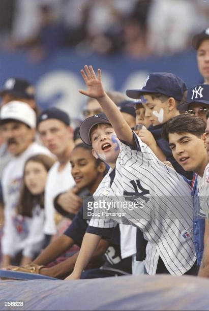 A fan of the New York Yankees cheers on his team during game six of the World Series against the Atlanta Braves at Yankee Stadium in Bronx New York...