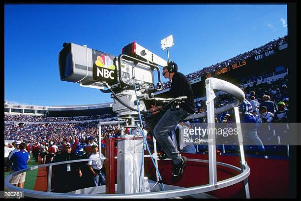 A NBC camera crew films the action during a game between the Buffalo Bills and the Indianapolis Colts at Rich Stadium in Orchard Park New York The...